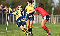 Rhi Parker offloading in the tackle