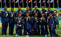 Fiji team posing with their gold medal after winning the Olympic rugby sevens