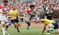Kenki Fukuoka scores a try against Romania on Saturday in Kumamoto.