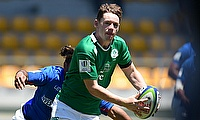 Ireland full-back Alan Tynan looks to pass during their ninth place semi-final with Samoa