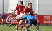 Wales full-back Phil Jones tries to burst through an Italian tackle in their seventh place play-off at Avchala Stadium