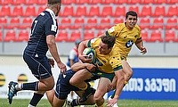 Australia's Nick Jooste is tackled in their fifth place play-off with Scotland at Avchala Stadium