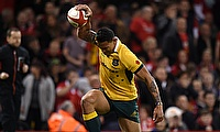 Israel Folau scored two tries as Australia edged to victory