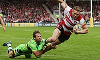 Gloucester's Jason Woodward beats the tackle of Northampton's Cobus Reinach to touch down