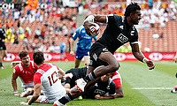 New Zealand's Joe Ravouvou runs through the France defense on day one