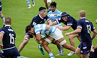 Argentina's Salvador Ochoa tries to burst through the Scotland defence on day two of the World Rugby U20 Championship 2018