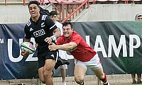 New Zealand winger Bailyn Sullivan tries to race away from the Wales defence on day two of the World Rugby U20 Championship 2018