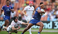 Samoa's Alatasi Tupou cuts through the England defense on day one of the HSBC World Rugby Sevens Series in Hamilton