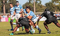 Argentina charge at the Fiji defence in their Pool A match at Club de Rugby Ateneo Inmaculada
