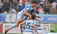 Argentina's players celebrate the victory over defending champions France that earned them top spot in Pool A at the Racecourse Stadium