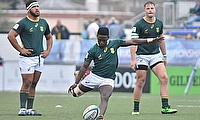 Sanele Nohamba kicks for goal for South Africa in their Pool C decider with New Zealand at the Racecourse Stadium