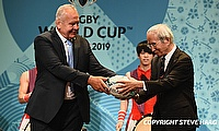 Chairman of the World Rugby Bill Beaumont passes the ball to Chairman of the Japan Rugby Football Union