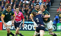 John Quill of the USA tackling Schalk Burger of South Africa