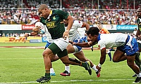 South Africa's Zain Davids charges through the Samoa defence to score a try in their Cup semi-final on day three of the Emirates Airline Dubai Rugby S