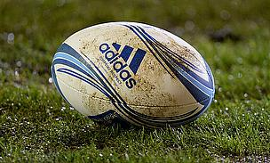 A rugby ball lies on the floor