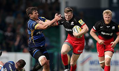 Chris Ashton, pictured centre, scored a hat-trick of tries for Saracens