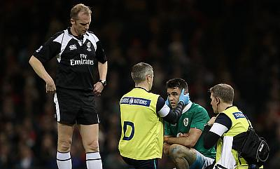 Conor Murray, pictured centre, needed treatment after suffering a shoulder injury in Wales