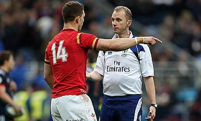 Wales wing George North in discussion with referee Wayne Barnes during Saturday's Six Nations clash against France