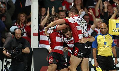 Jason Woodward (centre) is mobbed by his Gloucester team-mates after scoring the winning try