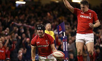 Wales' Leigh Halfpenny (left) celebrates scoring his side's third try during the NatWest 6 Nations match at the Principality Stadium, Cardiff