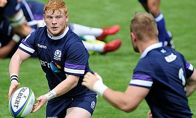 Scotland hooker Robbie Smith passes during their ninth place semi-final with Ireland on day four of the World Rugby U20 Championship 2018