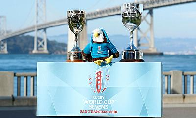 ugby World Cup Sevens 2018 mascot Rookie and the two trophies at the captains' photo at Cupid's Span in San FranciscoRugby World Cup Sevens 2018 masco