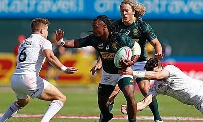 South Africa's Branco cu Preez fends off the England defence on day two of the Emirates Airline Dubai Rugby Sevens 2018