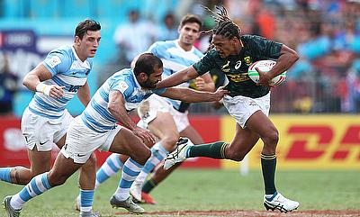 South Africa's Justin Geduld fends off the Argentina defense on day one of the HSBC World Rugby Sevens Series in Sydney