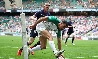 Ireland's Jordan Conroy scores a try against Scotland on day one of the HSBC World Rugby Sevens Series at Twickenham Stadium in London