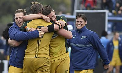 Australia's players celebrate after beating Argentina in their semi-final at the Racecourse Stadium in Rosario on day four of the World Rugby U20 Cham