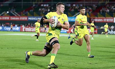 Australia captain Nick Malouf attacks against the Scotland defence on day one of the Emirates Airline Dubai Rugby Sevens