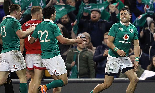 Tiernan OHalloran, right, scored Ireland's seventh try against Canada