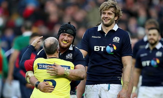 Scotland prop Zander Fagerson, left in scrum cap, has hit out at plans to squeeze the RBS 6 Nations in to a four-week window