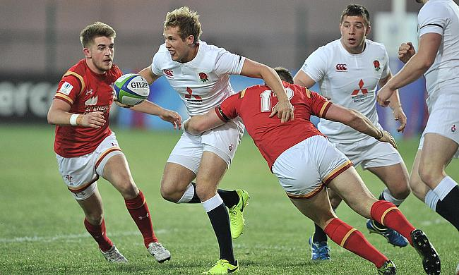 England captain Max Malins tries to burst through the Welsh defence in their Pool A match at Avchala Stadium