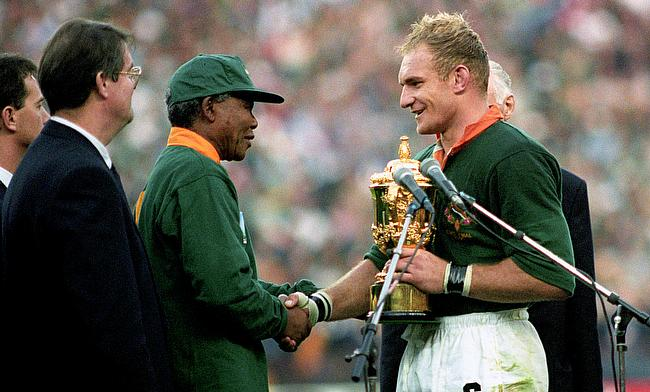South Africa captain Francois Pienaar receives the World Cup from Nelson Mandela
