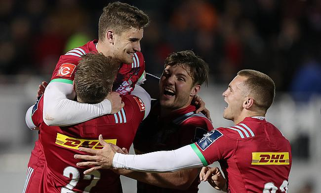 Harlequins James Lang is congratulated by team mates after kicking the winning conversion during the Anglo Welsh Cup match at Allianz Park, London.
