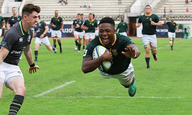 South Africa centre Wandisile Simelane scores one of his three tries in their Pool C win over Ireland