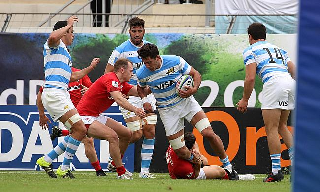 Argentina number eight Santiago Ruiz tries to shrug off a Wales tackle in their fifth place semi-final