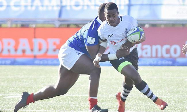 France's Jordan Joseph tries to stop another Fiji attack in their Pool A match at the Racecourse Stadium in Rosario on day one of the World Rugby U20
