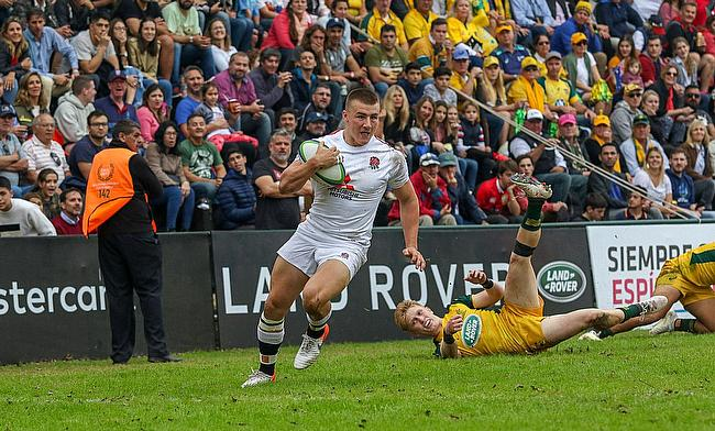 England run in a try against Pool B winners Australia at Club de Rugby Ateneo Inmaculada