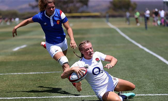 Kelly Smith (right) scoring a try for England