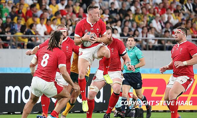 Wales battle past Fiji to reach quarter-finals